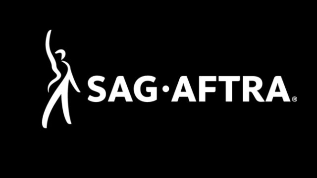 the sag-aftra logo with a man wearing a tuxedo raising his arm above his head in triumph