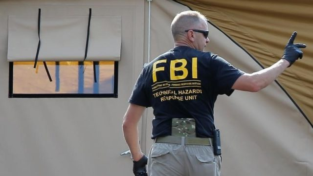 An FBI investigator works at the crime scene of a mass shooting at the Pulse gay night club in Orlando, Florida, U.S. June 13, 2016. REUTERS/Jim Young