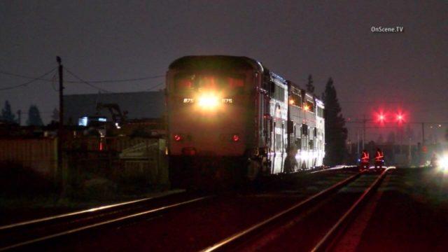 A Metrolink train at night in Orange County.