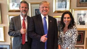 Jerry Falwell and wife, Becki (near Playboy cover), flank Donald Trump. Photo via Twitter.