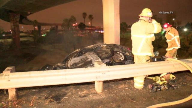 One person was killed this morning when a car went off of the Riverside (91) Freeway, landed next to a transition road and burst into flames, authorities said. Photo via OnScene.TV.
