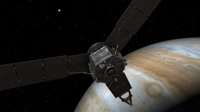 This illustration depicts NASA's Juno spacecraft at Jupiter, with its solar arrays and main antenna pointed toward the distant sun and Earth. NASA's Jet Propulsion Laboratory, Pasadena, Calif., manages the Juno mission for the principal investigator, Scott Bolton, of Southwest Research Institute in San Antonio. The Juno mission is part of the New Frontiers Program managed at NASA's Marshall Space Flight Center in Huntsville, Ala. Lockheed Martin Space Systems, Denver, built the spacecraft. JPL is a division of the California Institute of Technology in Pasadena. More information about Juno is online at http://www.nasa.gov/juno and http://missionjuno.swri.edu. Photo via NASA/JPL-Caltech