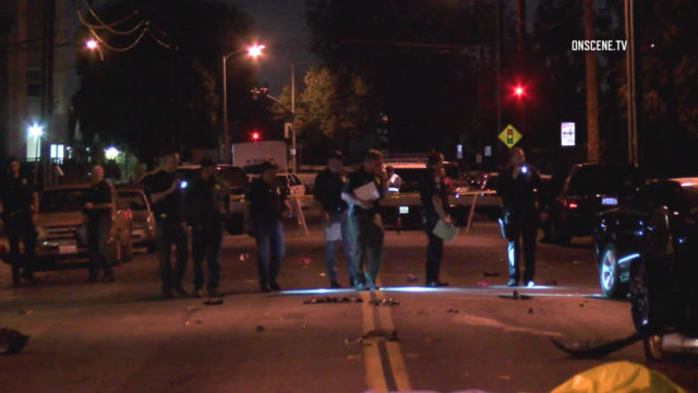 Police examine the street for evidence after a woman and two children were killed. Courtesy of OnScene.TV