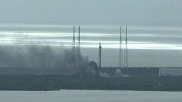 Smoke billows from the SpaceX launch site. Reuters via NASA TV