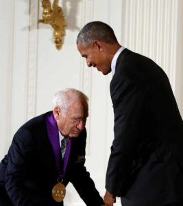 Mel Brooks lowers himself as of for a knighthood in front of President Obama. Photo by Gary Cameron via Reuters