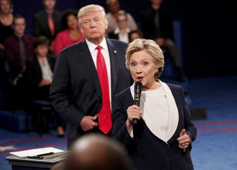 Republican U.S. presidential nominee Donald Trump listens as Democratic nominee Hillary Clinton answers a question from the audience during their presidential town hall debate at Washington University in St. Louis. REUTERS/Rick Wilking