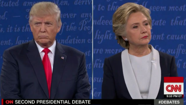 Split screen coverage by CNN shows Donald Trump and Hillary Clinton.