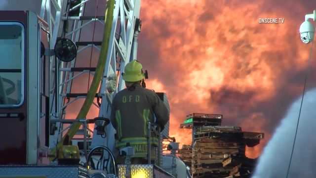 Firefighters battle the massive fire in Ontario. Courtesy OnScene.TV
