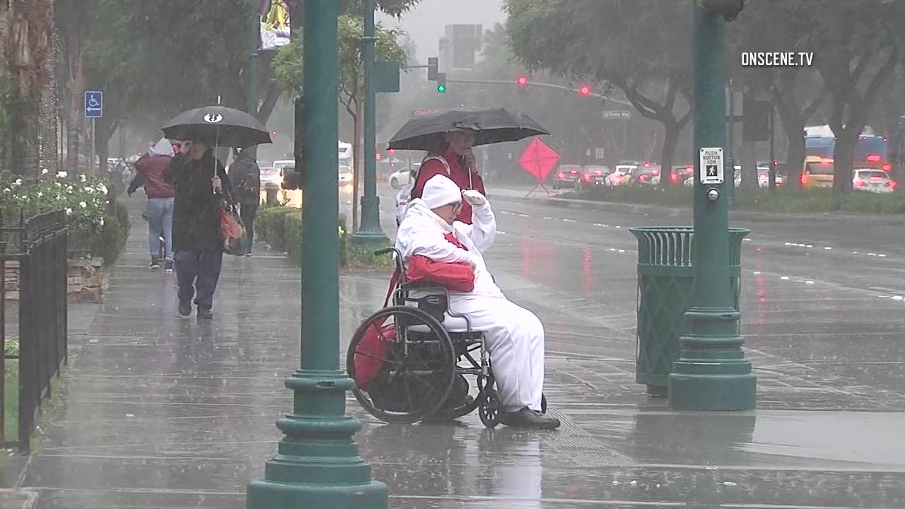 Pouring rain near the entrance to Disneyland on Saturday afternoon. Courtesy OnScene.TV