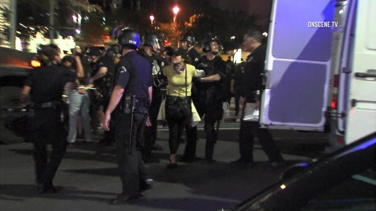 Police arrest a protester on Friday night. Courtesy OnScene.tv
