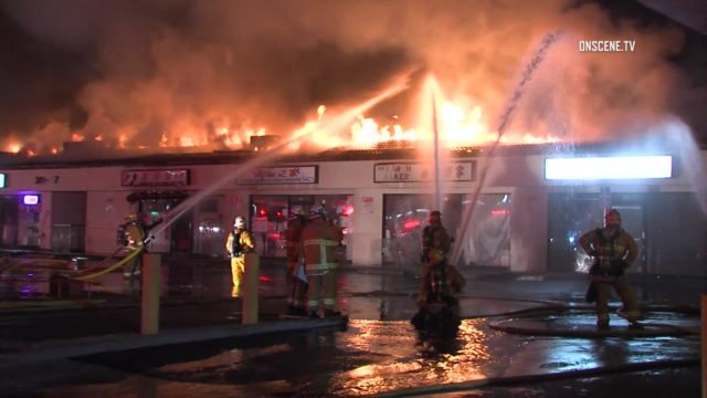 Two firefighters were injured while battling a four-alarm fire Thursday at a Monterey Park strip mall. Photo via OnScene.TV.