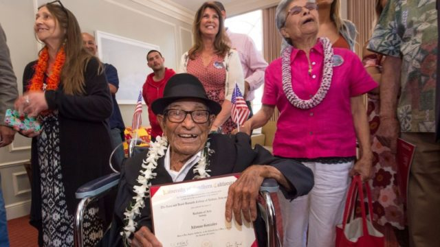 Alfonso Gonzales, USC's oldest graduating Trojan at 96, receives his diploma. USC Photo/Gus Ruelas