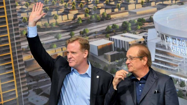 NFL Commissioner Roger Goodell and Chargers Chairman Dean Spanos acknowledge a crowd of fans. Photo by Chris Stone