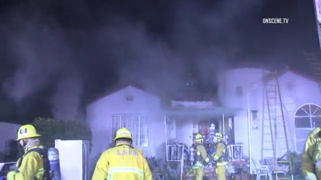 LAFD firefighters on the scene of the New Year's Eve blaze at 3421 Linda Vista Terrace. Photo: OnsceneTV