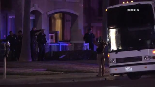 The party bus detained at the scene by Huntington Beach police, Photo: OnSceneTV