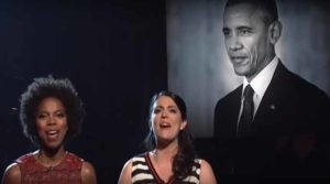 """Sasheer Zamata (left) and Cecily Strong sing """"To Sir, With Love"""" on SNL. Image via YouTube.com"""