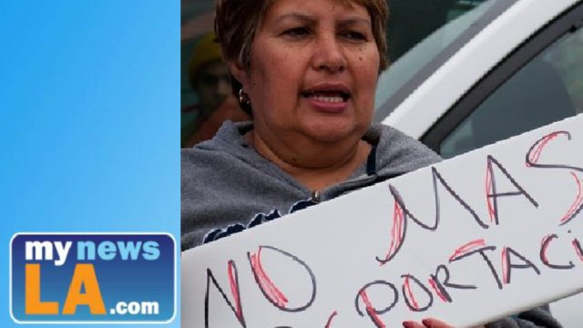 A woman protests deportation practices. Photo: CHIRLA