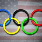 olympic rings over a US flag
