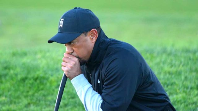 Tiger Woods dresses warmly for pro-am portion of Farmers Insurance Open. Photo by Chris Stone