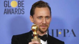 """Actor Tom Hiddleston holds the award for Best Performance by an Actor in a Limited Series or a Motion Picture Made for Television for his role in """"The Night Manager"""" during the 74th Annual Golden Globe Awards in Beverly Hills on Jan. 8, 2017. Photo by Mario Anzuoni via Reuters"""