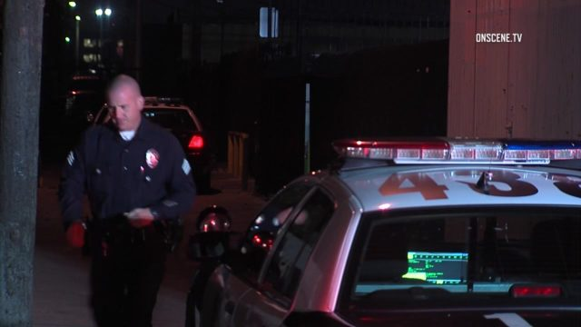 A Los Angeles Police officer at the scene of the shootings. Courtesy OnScene.TV
