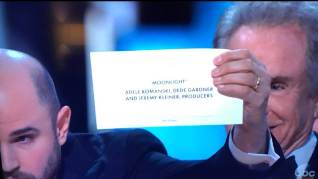 """""""La La Land"""" crew members show the real Best Picture winner to the audience. Image: Twitter"""