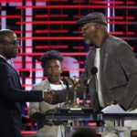 "Writer and director Barry Jenkins accepts the Best Feature award for the film ""Moonlight"" from presenter Samuel L. Jackson (right) as young actor Jaden Piner (center) from the movie looks on at the 2017 Film Independent Spirit Awards in Santa Monica. REUTERS/Mario Anzuoni"