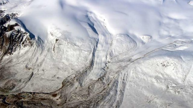 Canada's glaciers and ice caps are now a major contributor to sea level change, a new UCI study shows. Ten times more ice is melting annually due to warmer temperatures. Seen here is the edge of the Barnes Ice Cap in May 2015. NASA / John Sonntag