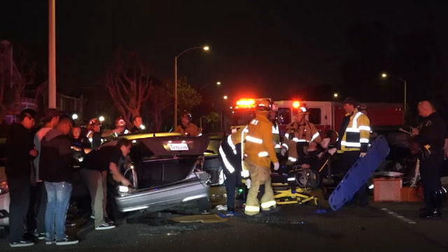 Firefighters remove one of the injured at the crash scene. Courtesy OnScene.TV