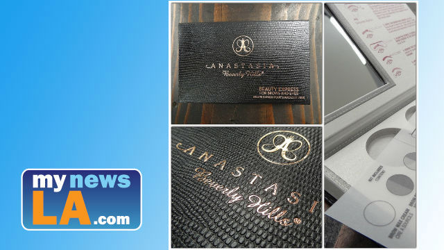 An example of Anastasia Beverly Hills cosmetics ,Hinged rigid box wrapped in embossed paper with hot stamp logo. Photo via Flickr https://www.flickr.com/photos/designpackaging/9807854614