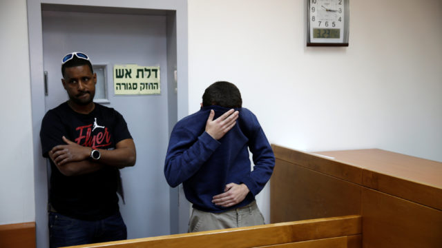 A U.S.-Israeli teen arrested in Israel on suspicion of making bomb threats against Jewish community centers appears at a court hearing in Rishon Lezion, Israel. REUTERS/Baz Ratner