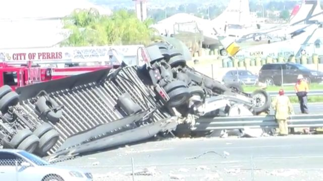 The big rig, carrying hundreds of pounds of produce, went out of control on the 215 Freeway's northbound side, crashed through the center divider guardrail and flipped over, coming to rest across all three southbound lanes. March 6, 2017. Photo: OnSceneTV