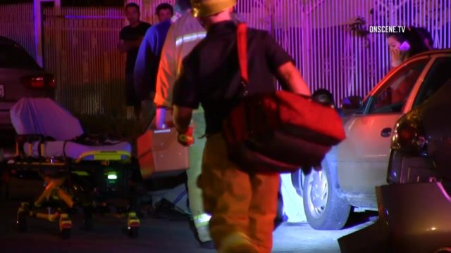 Paramedics arrive to assist the injured woman in South Los Angeles. Courtesy OnScene.TV