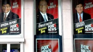 Posters featuring Fox News Channel talent including TV anchor Bill O'Reilly are seen outside the News Corporation headquarters in New York City, in New York, U.S. April 19, 2017. Photo by Shannon Stapleton via Reuters