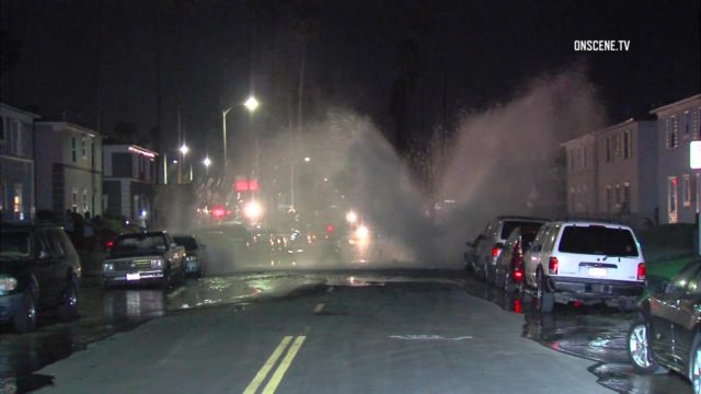 A water main ruptured early Friday in Arlington Heights, producing a powerful geyser that damage several car windows, according to reports from the scene. Photo via OnScene.TV.