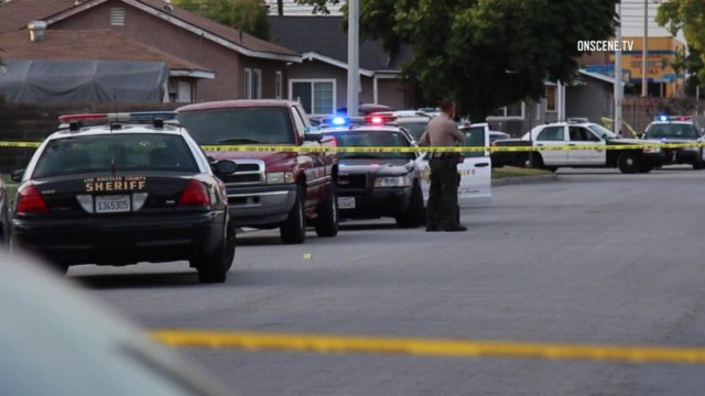 A 50-year-old man going door to door seeking to paint addresses on curbs was shot and killed in Norwalk. Photo via OnScene.TV.