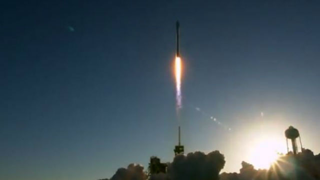 The Falcon 9 rocket climbs through the Florida sky seconds after launch. Image from video