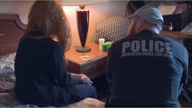 An officer talks with a sex trafficking victim. Courtesy FBI
