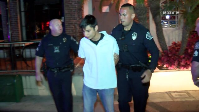 An armed man who posed as a city employee in an attempt to gain access to a Fullerton business was arrested Tuesday, police said. Photo via OnScene.TV.