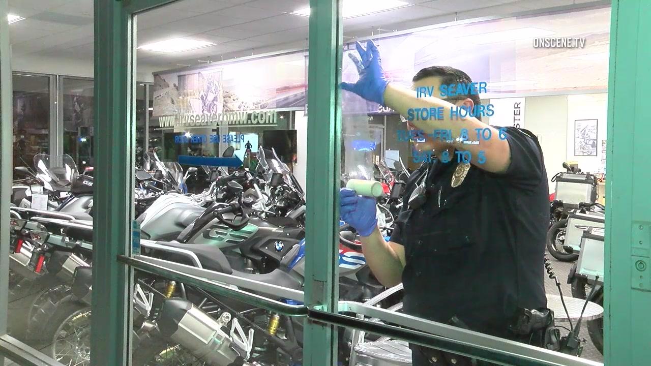burglars bust into orange bmw motorcycle shop, steal 2 bikes