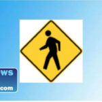 a pedestrian caution road sign.