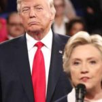 Donald Trump looms behind Hillary Clinton during presidential debate.