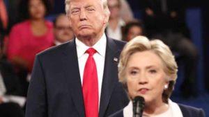 Donald Trump looms behind Hillary Clinton during presidential debate.
