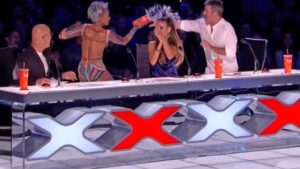 "Mel B tosses fizzy water at fellow judge Simon Cowell on ""America's Got Talent."""