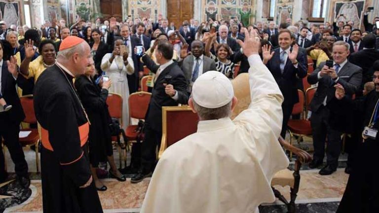 Sean Spicer (right) takes picture of Pope Francis at  Vatican.