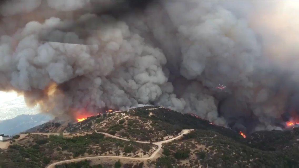 Firefighters battle flames near major Los Angeles freeway