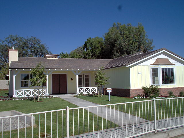 a typical california ranch style house on a large grass-filled lot in California