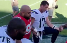Los Angeles Chargers quaterback Philip Rivers kneeling at StubHub Center