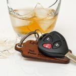Car keys and an alcoholic drink.
