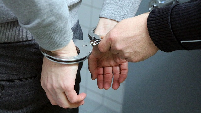 An example of handcuffs being placed on a subject.